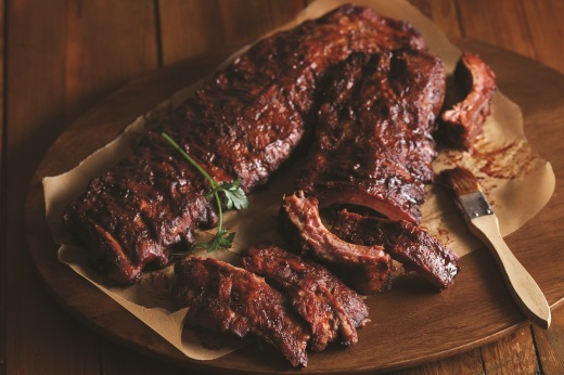 A perfectly-cooked rack of ribs should have just the right amount of char, and just enough sauce to add flavor without overpowering the meat